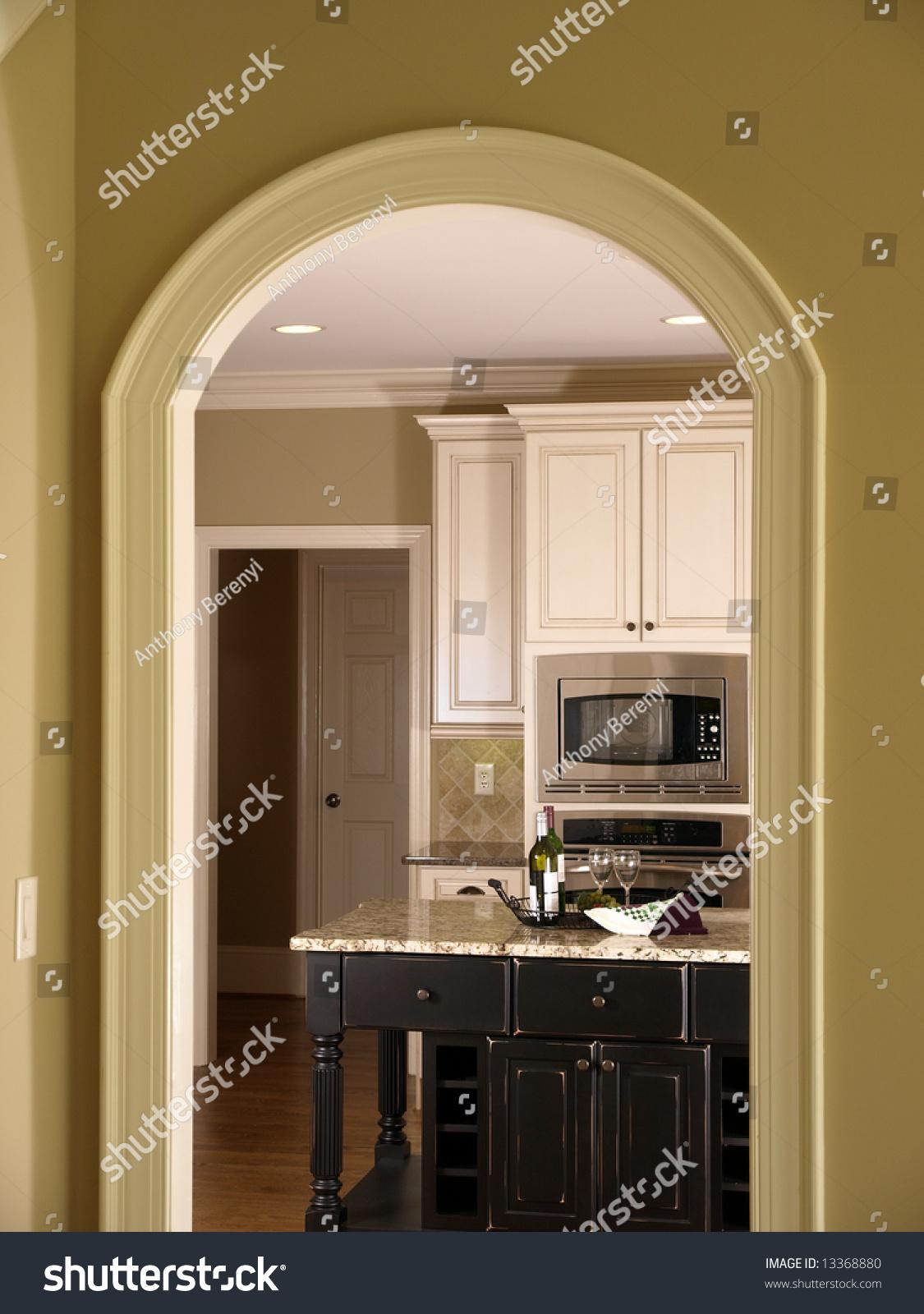 luxury model home kitchen through arch stock photo 13368880