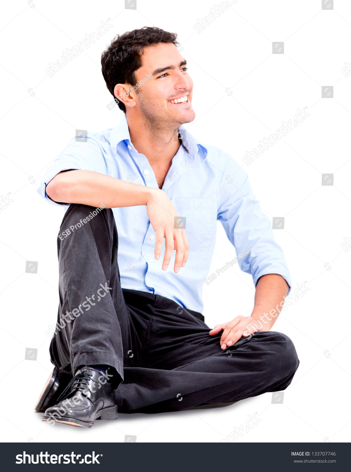 relaxed business man sitting on floor lagerfoto 133707746 shutterstock. Black Bedroom Furniture Sets. Home Design Ideas
