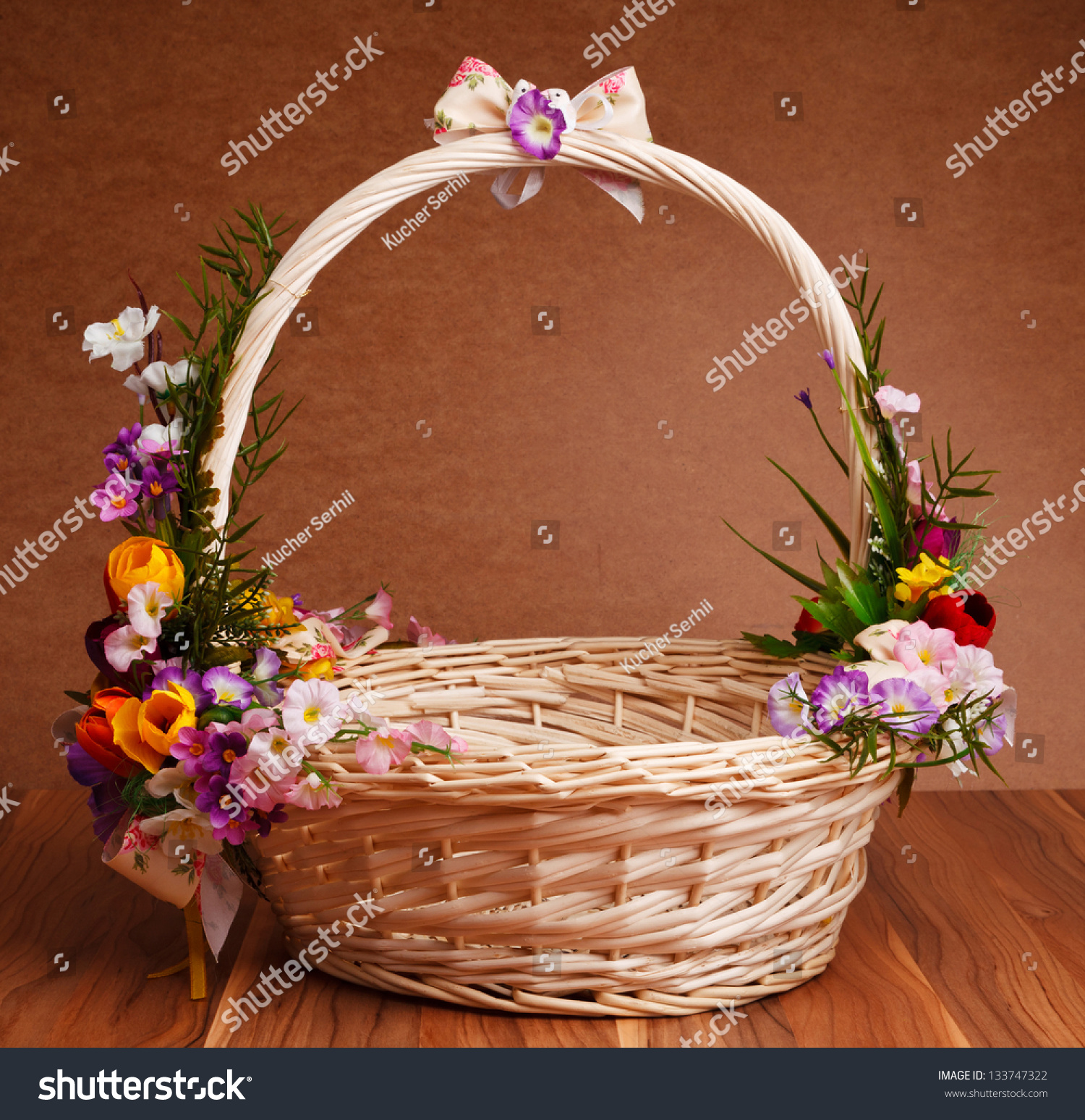 Basket Decorated Flowers On Wooden Table Stock Photo