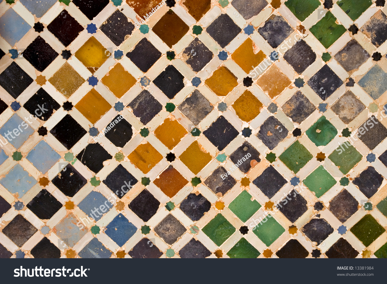 a view of decorative ceramic artwork found on a wall at the alhambra castle in granada - Ceramic Tile Castle Decoration