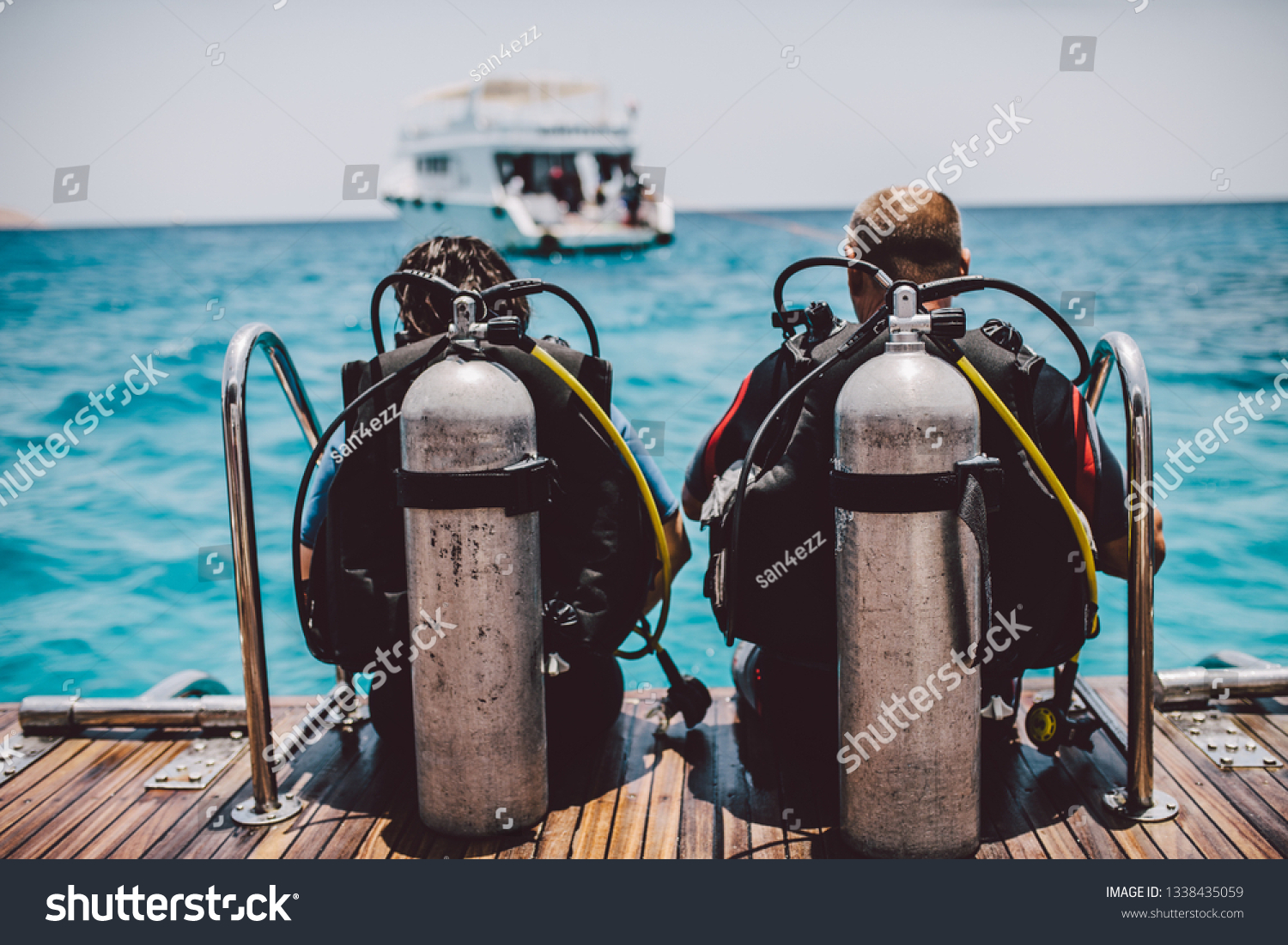 Diving lesson in open water. Scuba diver before diving into ocean. #1338435059