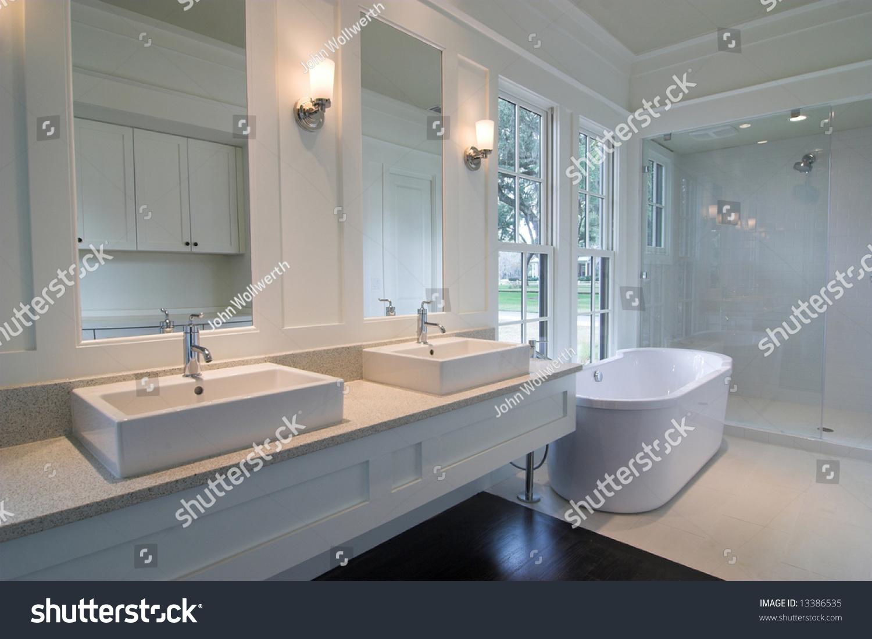 luxurious modern white bathroom with dark wood floors | EZ Canvas