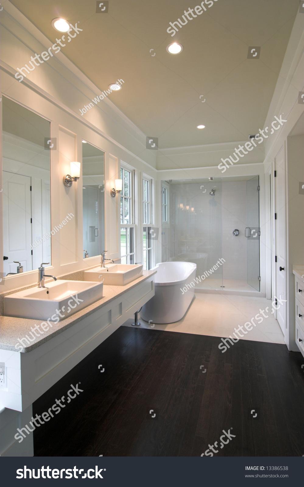 Dark wood floor bathroom - Luxurious Modern White Bathroom With Dark Wood Floors