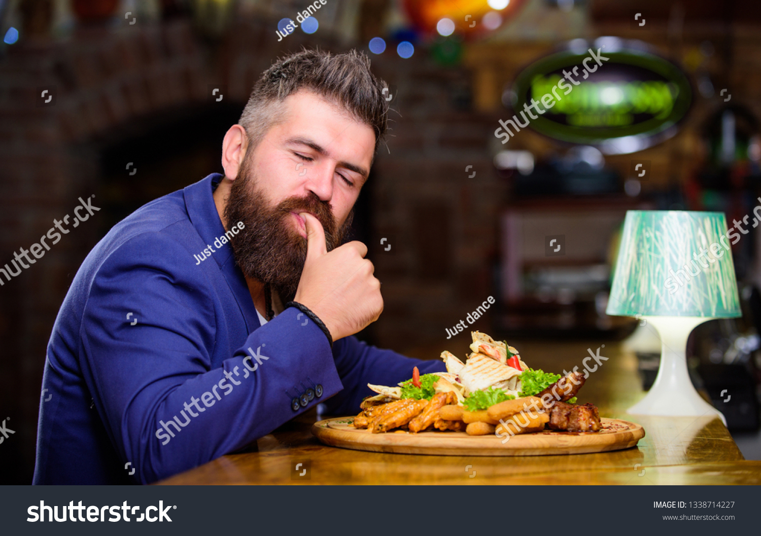 Businessman formal suit sit at restaurant. Man received meal with fried potato fish sticks meat. He deserve delicious meal. Enjoy your meal. High calorie snack. Delicious food. Relax after hard day.