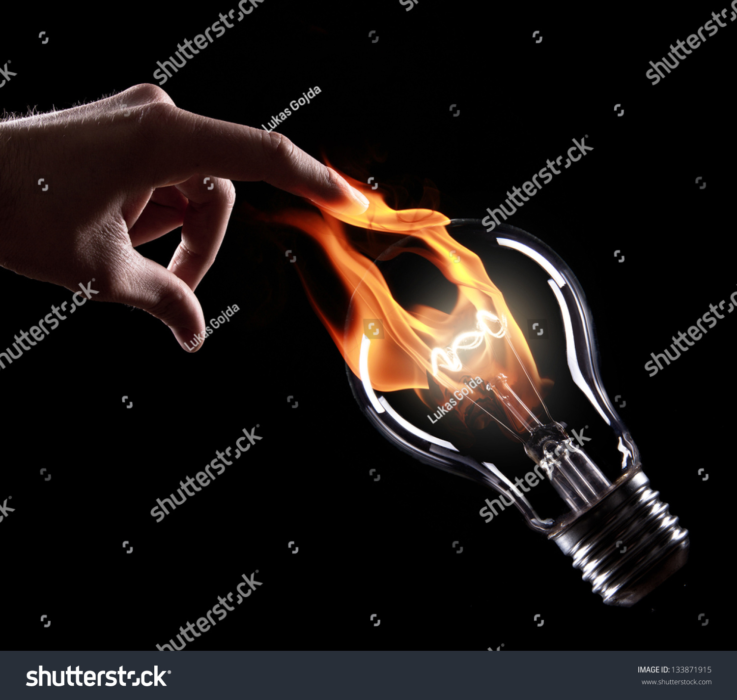 Fire Light Bulb: light bulb with fire on black background Preview. Save to a lightbox,Lighting