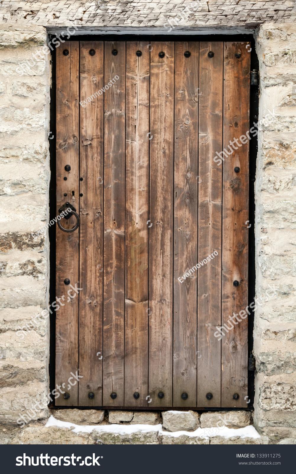 Ancient wooden door in old stone castle wall tallinn for Door of stone