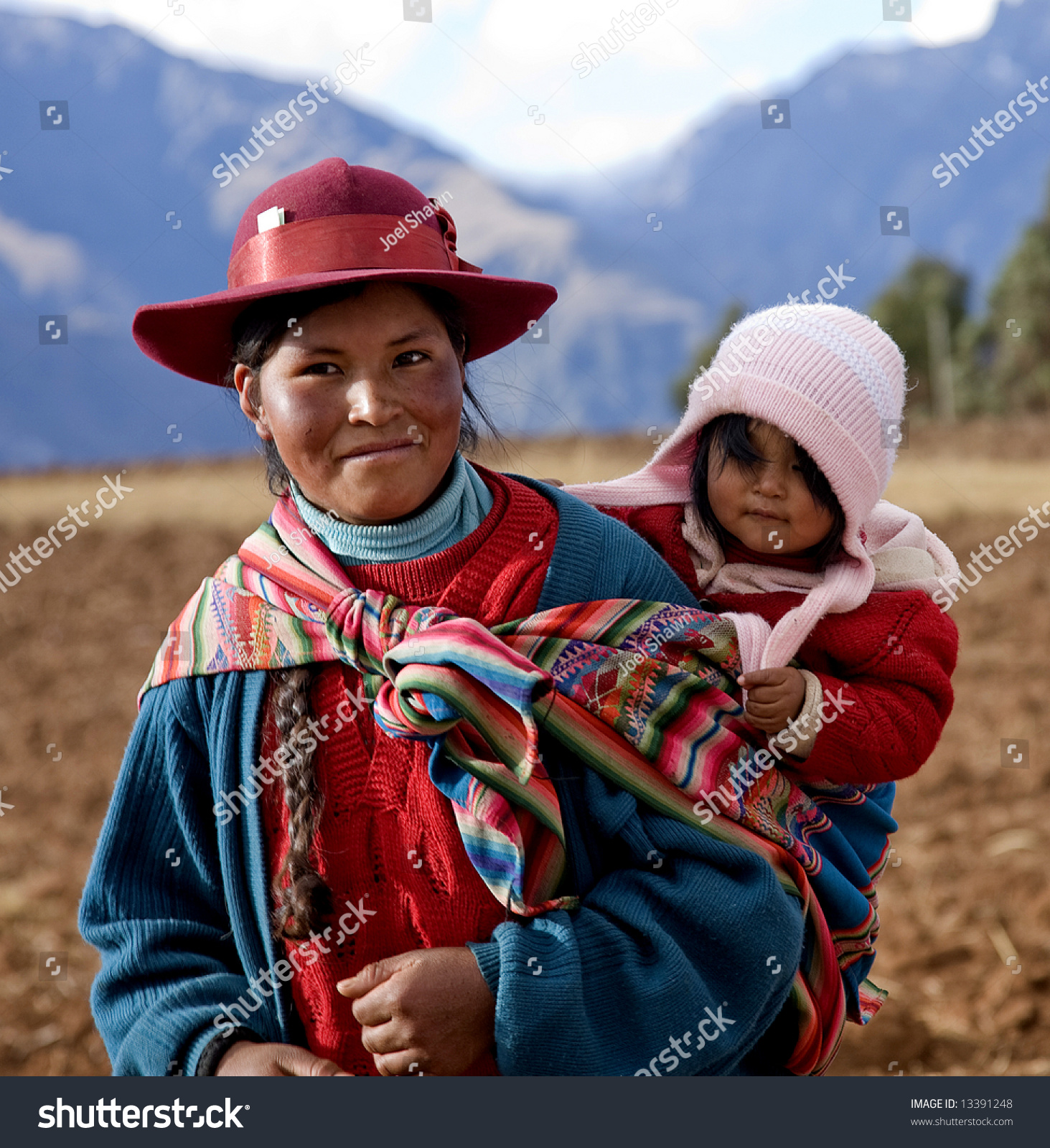 Peru Travel Tips Common Peruvian Phrases For Travel: Peruvian Woman Baby Native Clothing Sacred Stock Photo