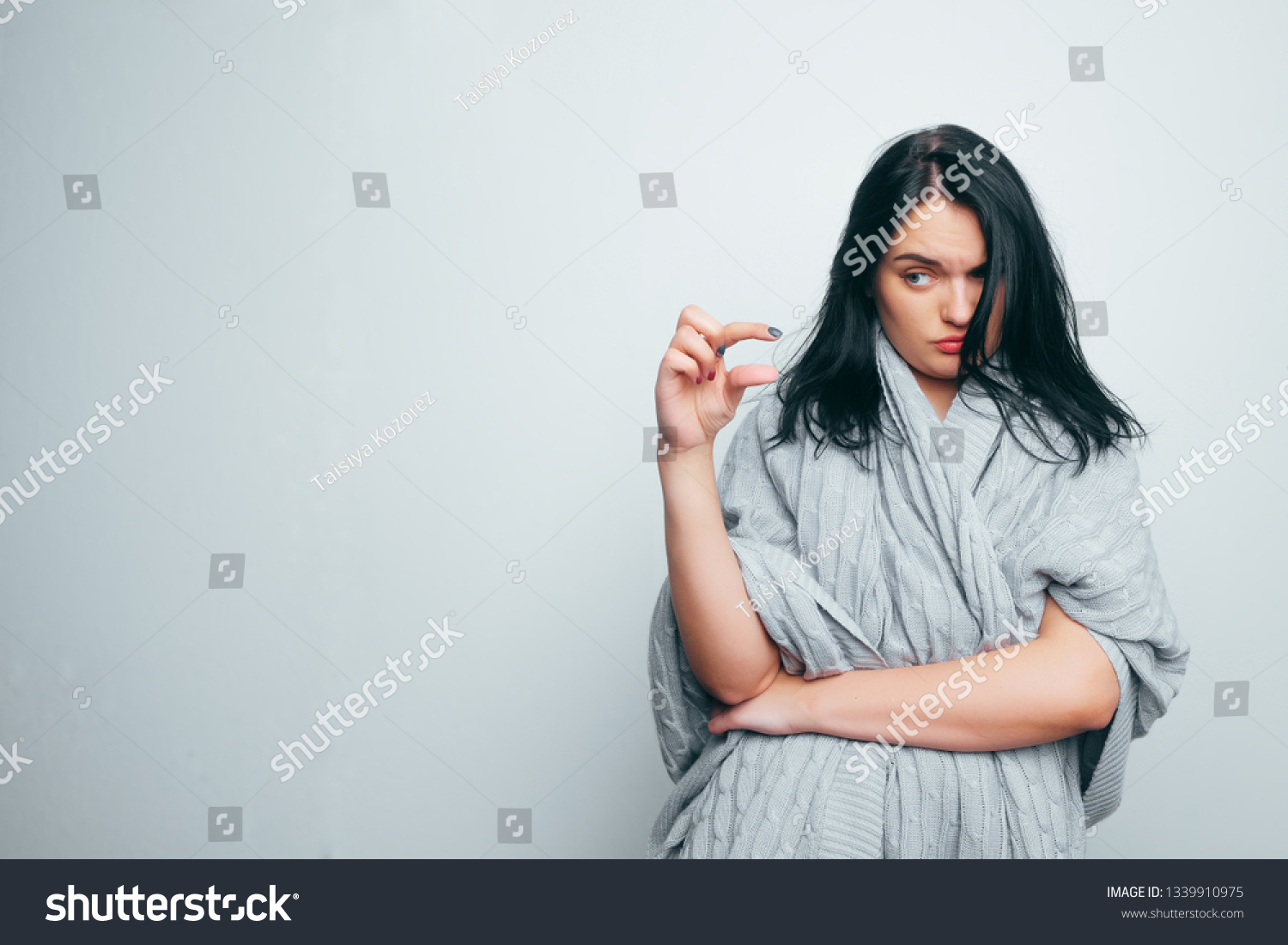 stock-photo-funny-excited-woman-showing-something-very-tiny-little-size-by-fingers-happy-girl-with-open-mouth-1339910975.jpg