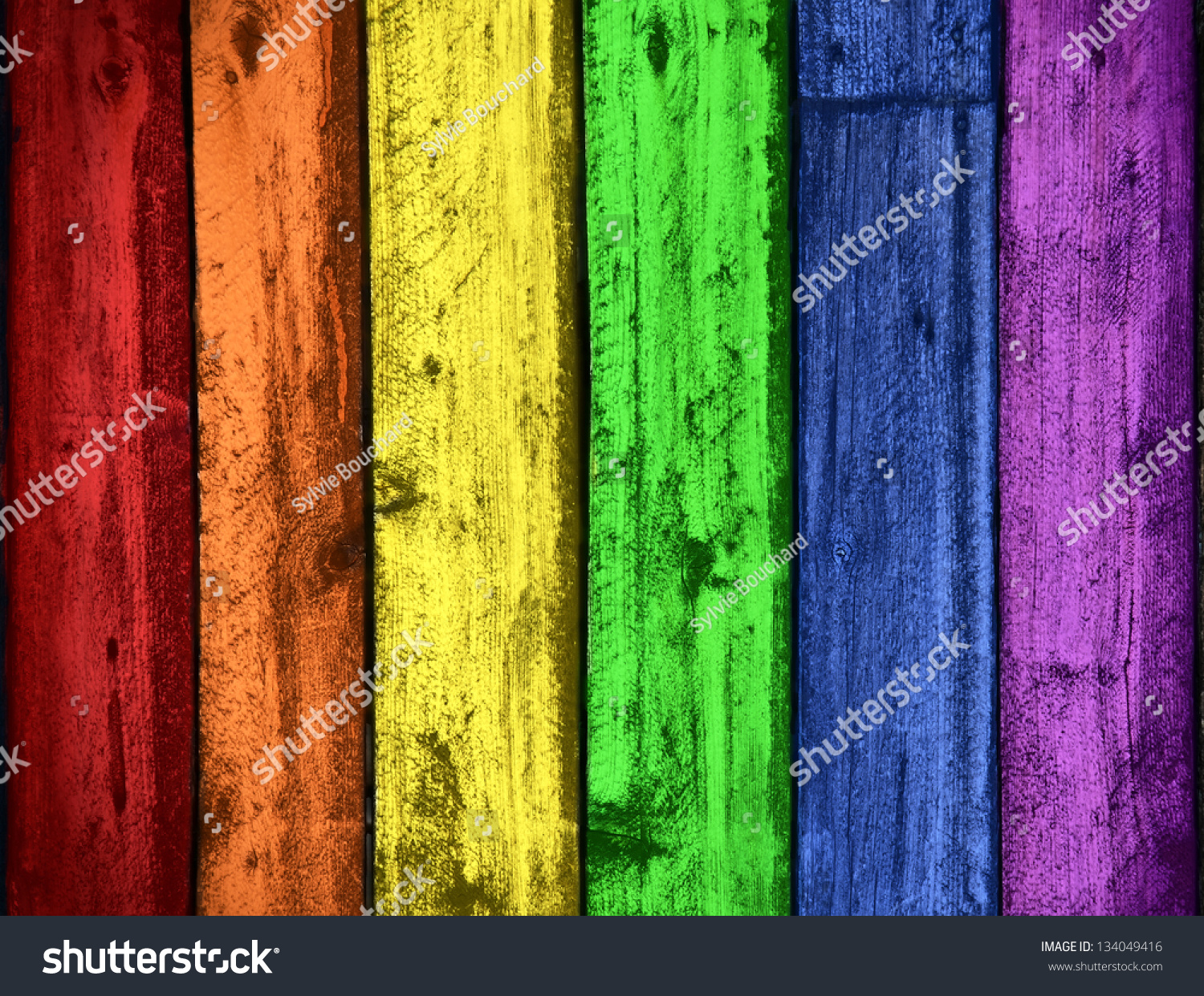 background of grungy old wood planks in rainbow colors