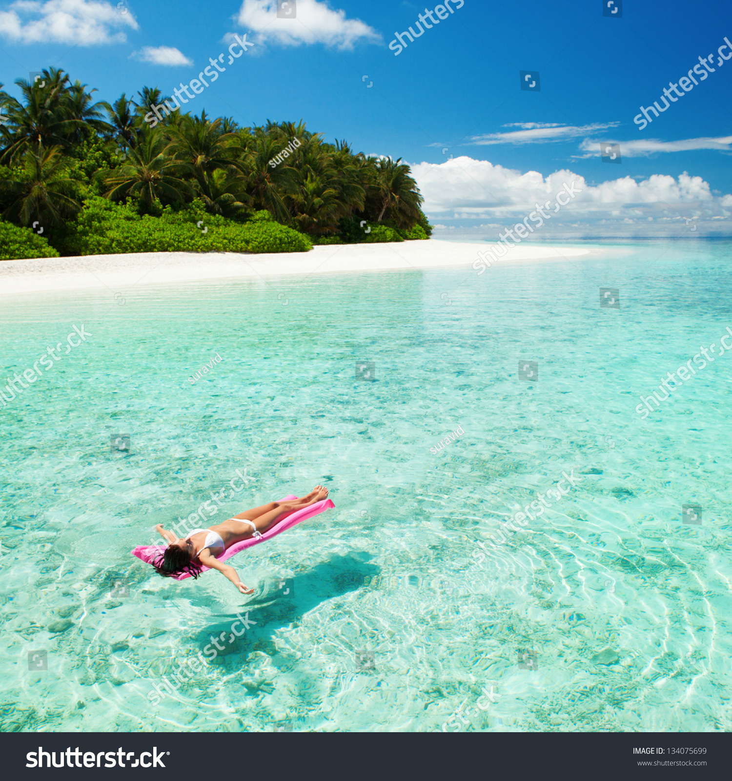 Woman Relaxing On Inflatable Mattress Sea Stock Photo