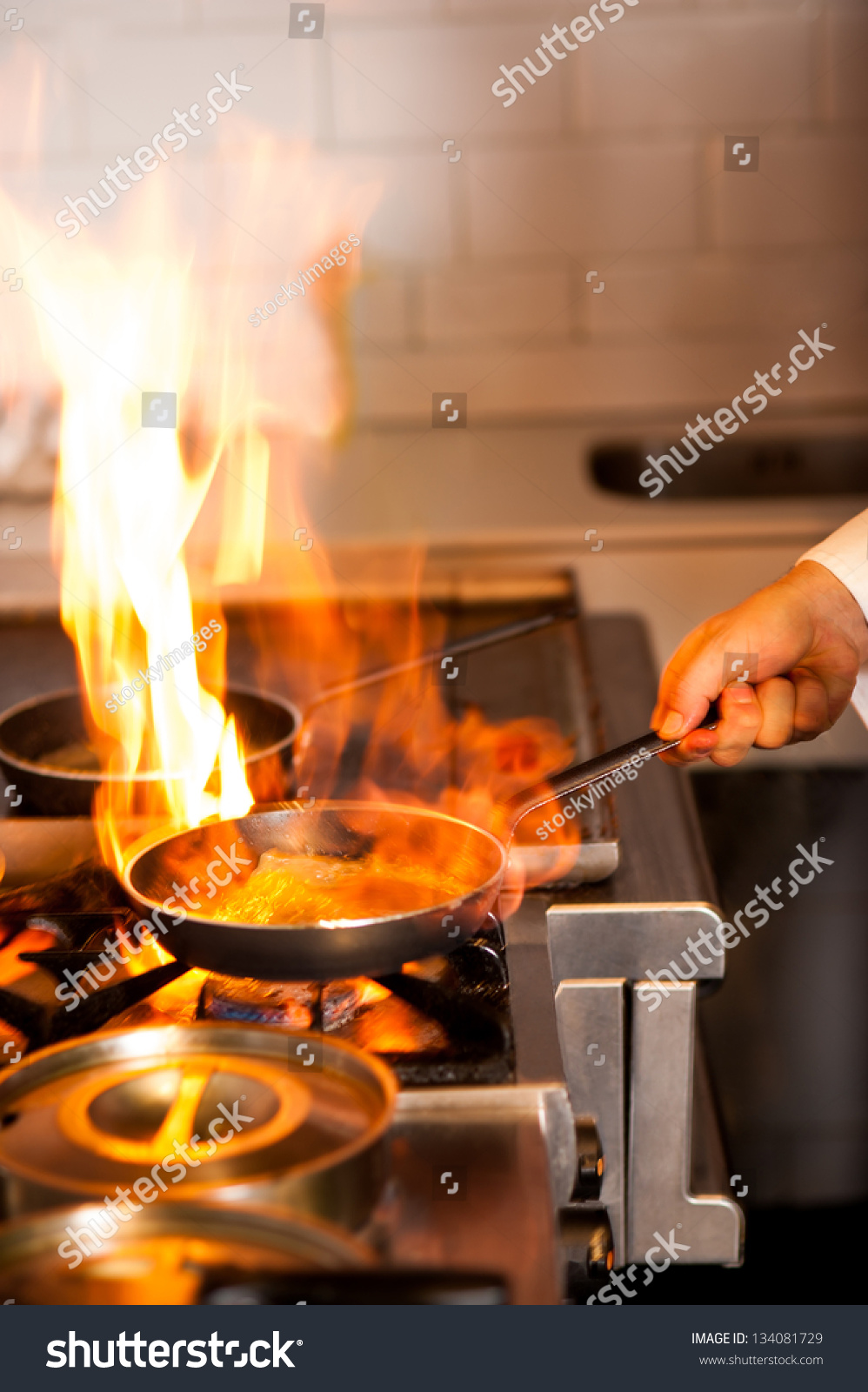 Chef Cooking Flame Frying Pan On Stock Photo 134081729