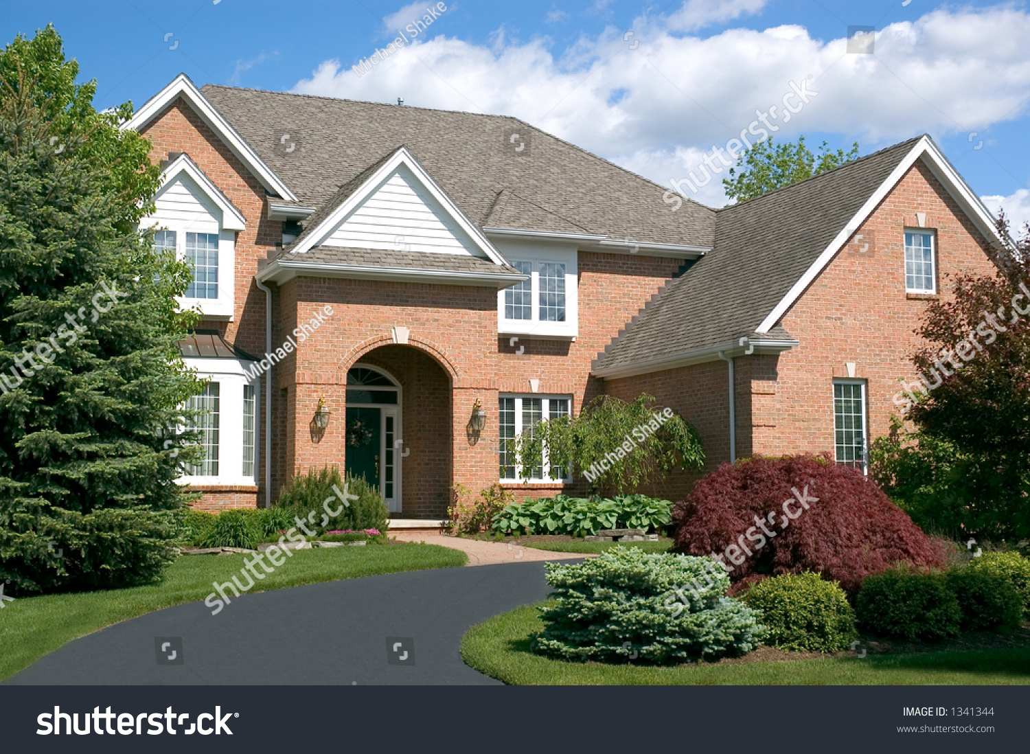 Beautiful brown two story brick home stock photo 1341344 for Beautiful one story homes