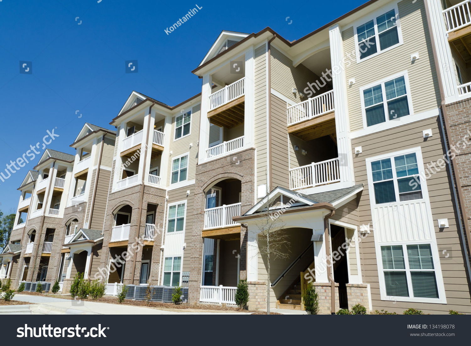 New apartment building in suburban area stock photo for Find a builder in your area