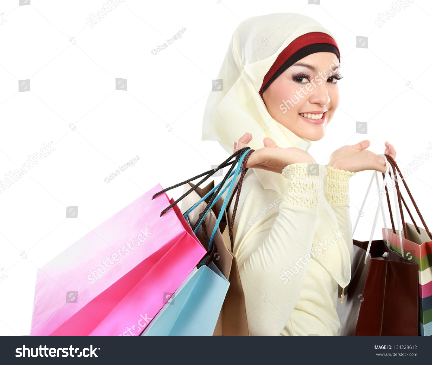 Woman posing with shopping bags isolated on white background full - Happy Young Muslim Woman With Shopping Bag Isolated Over White Background