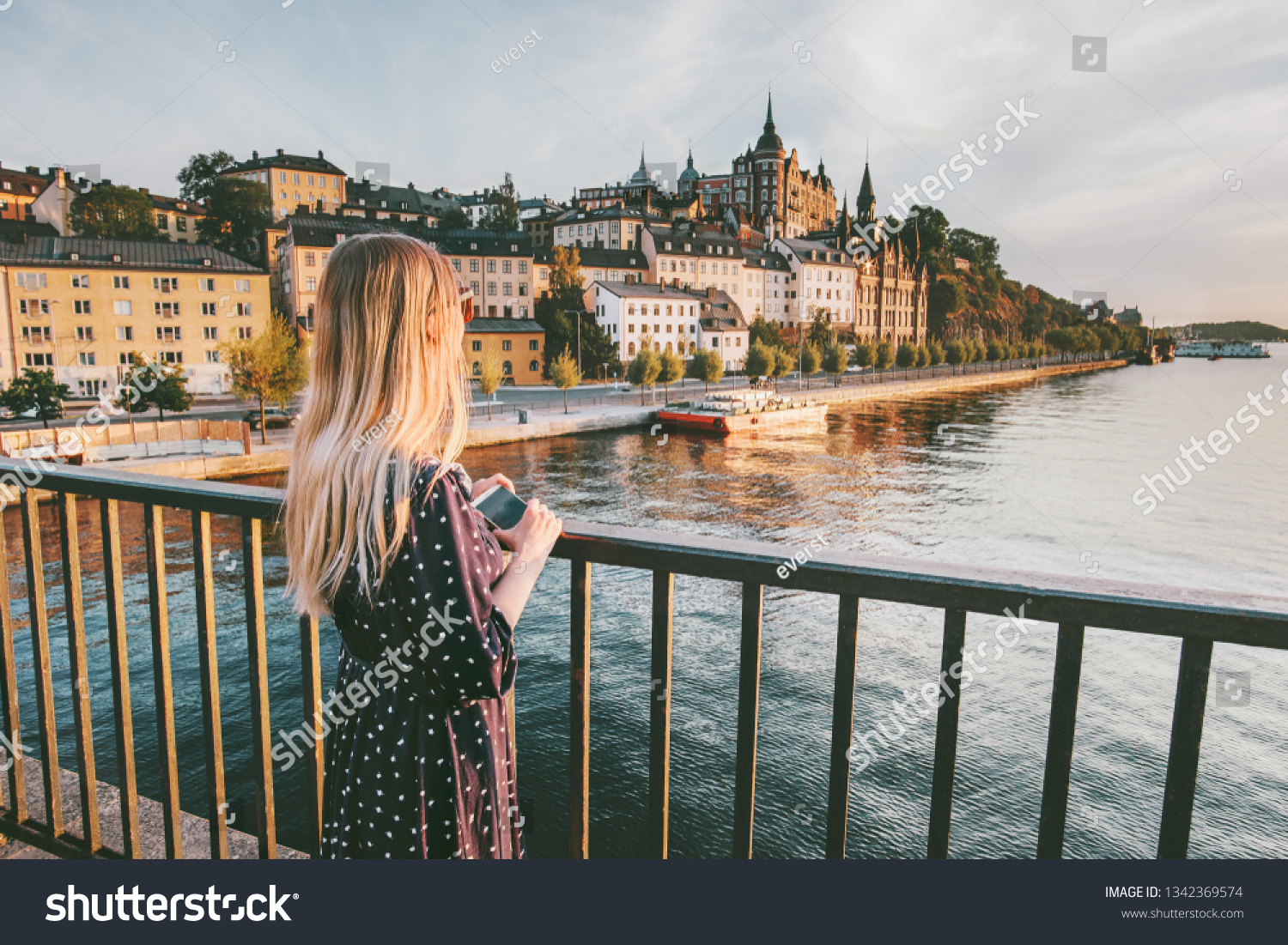 Tourist woman sightseeing Stockholm city enjoying view traveling lifestyle summer vacations in Sweden   #1342369574
