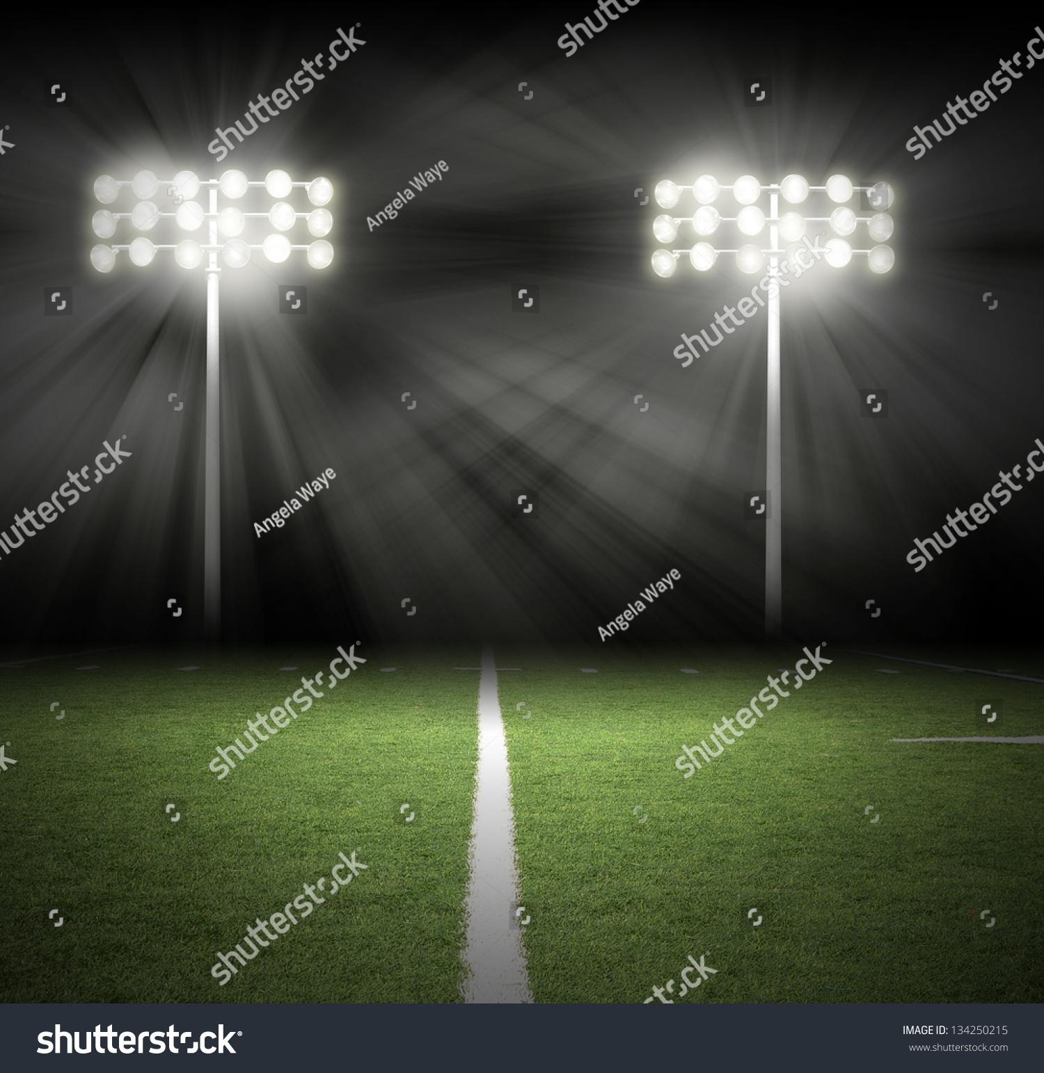 Stadium Of Lights: Two Stadium Football Game Lights Shinning Stock Photo