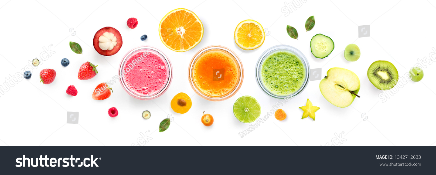 Creative layout made of smoothies and fruits around. Flat lay. Food concept. Smoothies on the white background. #1342712633