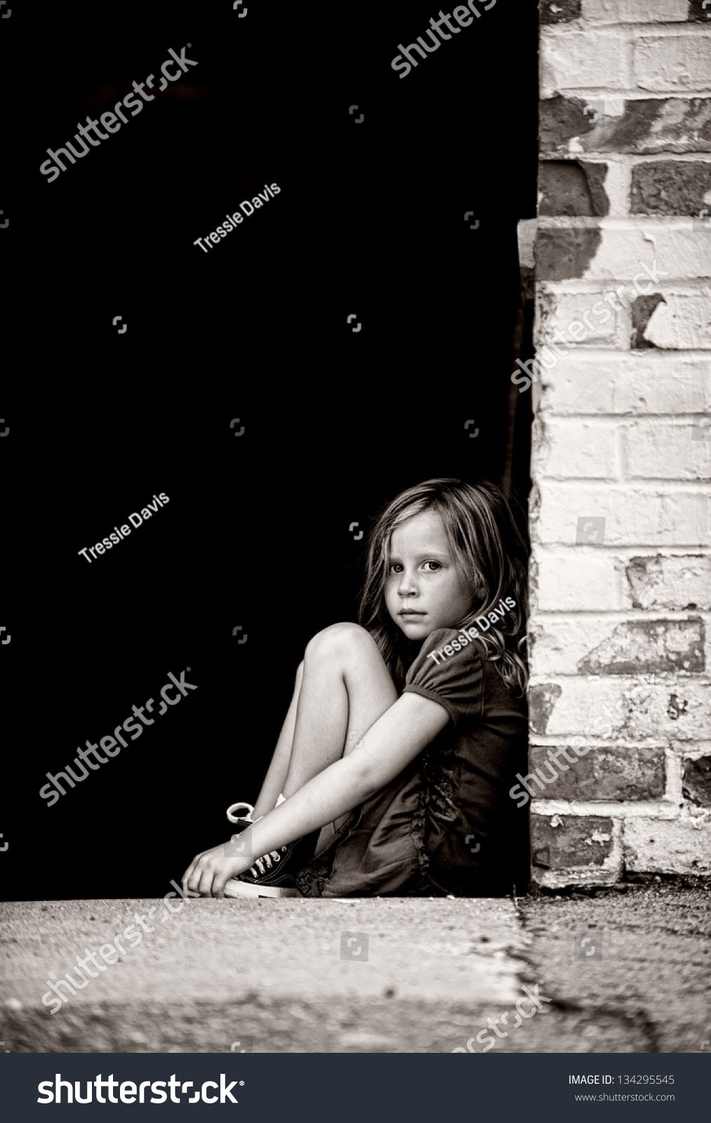 Sad Little Girl Sitting Alone On Stock Photo 134295545 ...