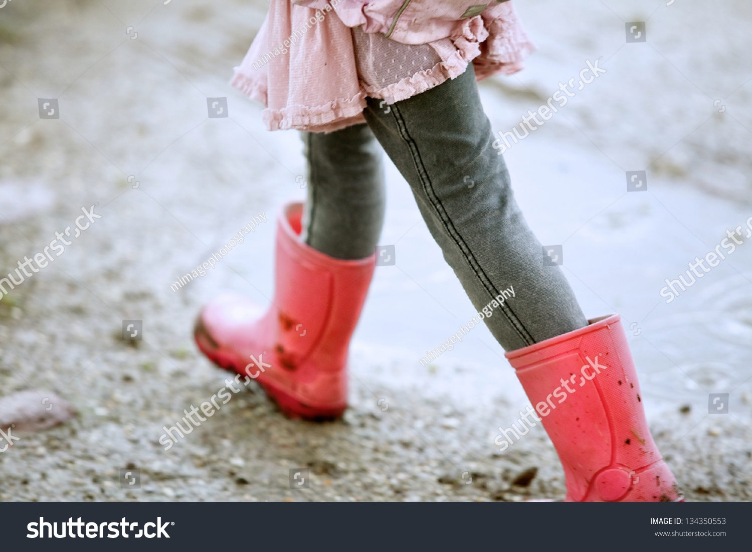 Close Up Little Girl Walking Outdoors With Red Boots Stock Photo ...