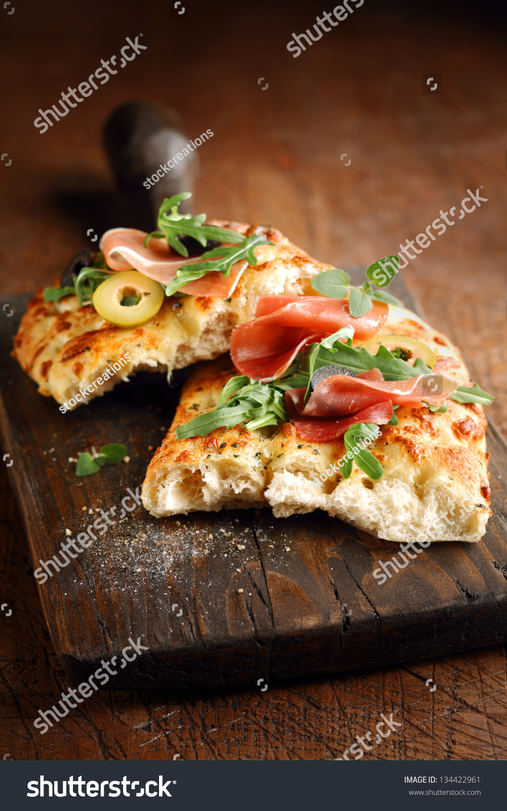 Freshly baked traditional savoury Italian focaccia bread topped with ...
