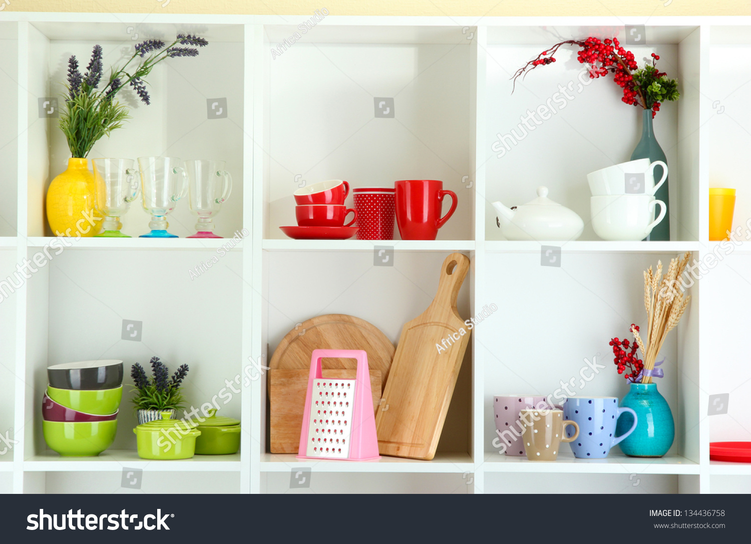 Beautiful white shelves with tableware and decor stock for Beautiful shelves images