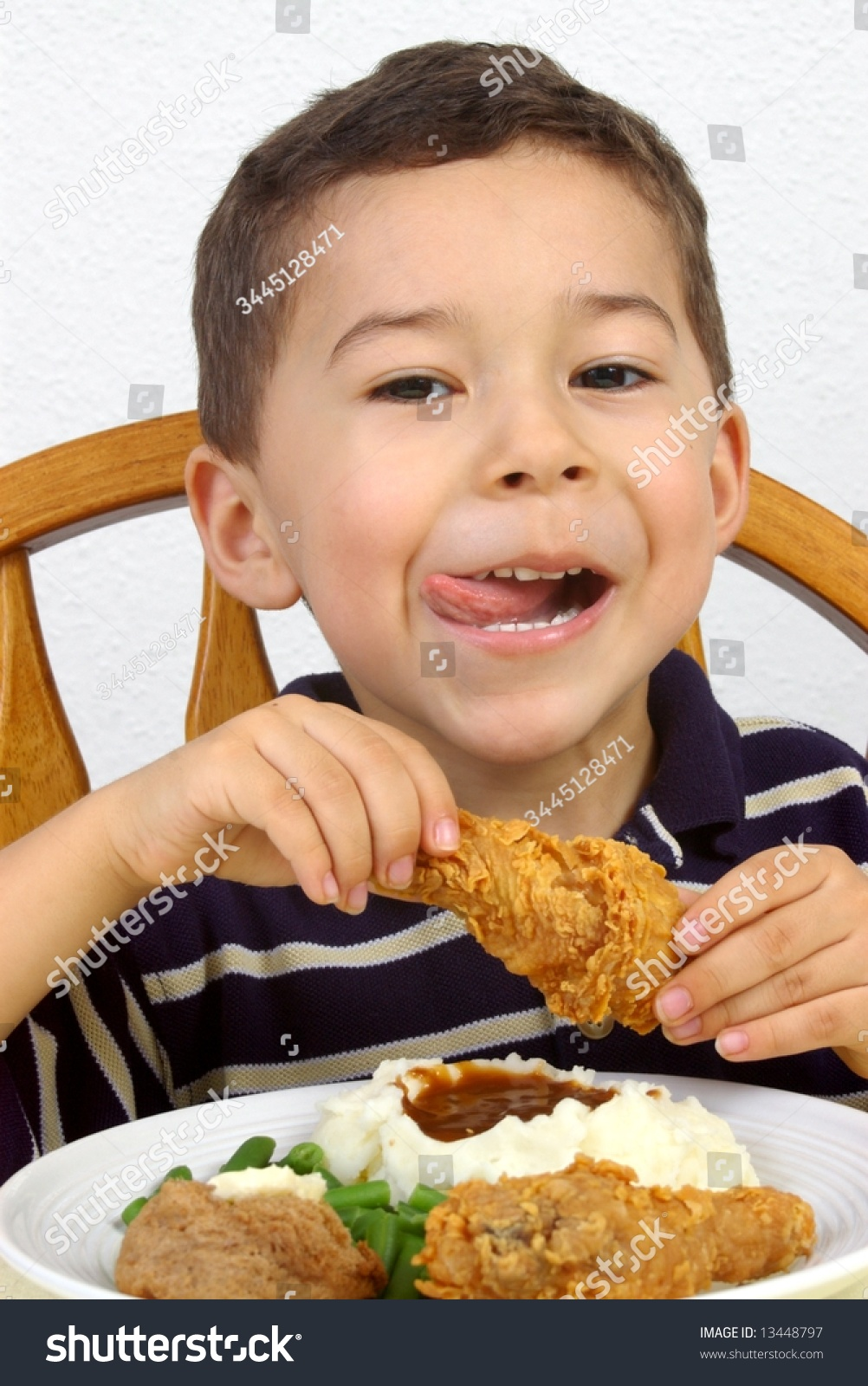 Boy Eating A Fried Chicken Dinner Stock Photo 13448797