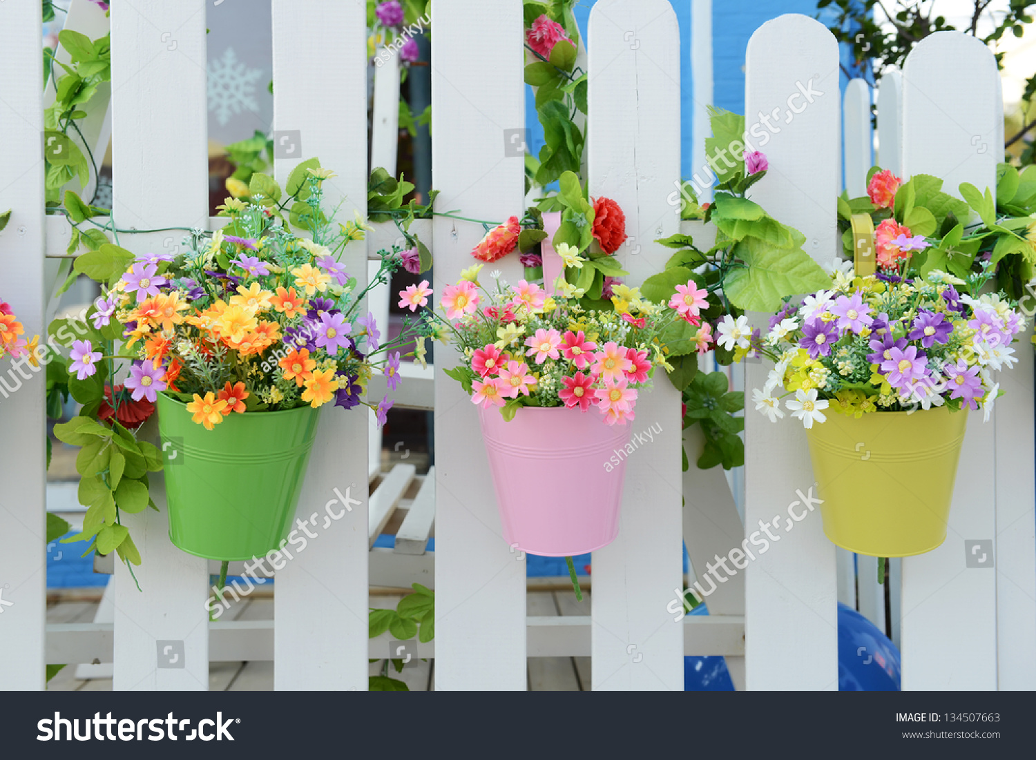 Hanging flower pots fence stock photo 134507663 shutterstock - Flower pots to hang on fence ...