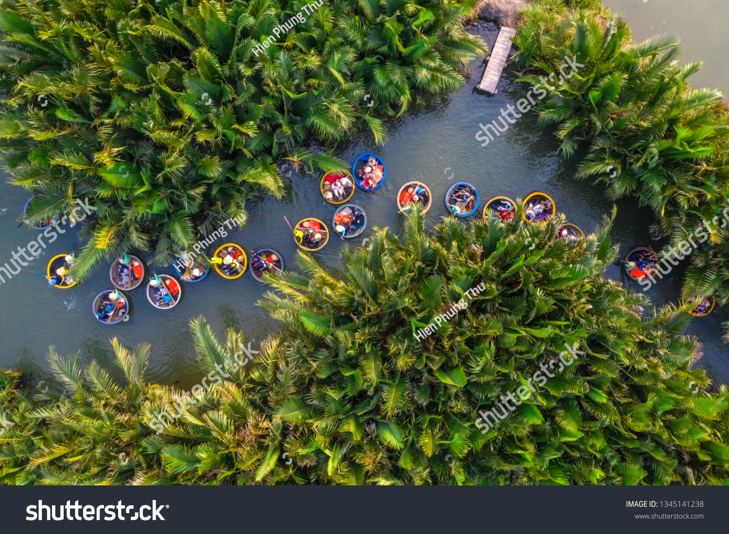 Aerial view, tourists from China, Korea, America and Russia are relax and experiencing a basket boat tour at the coconut water ( mangrove palm ) forest in Cam Thanh village, Hoi An, Quang Nam, Vietnam #1345141238