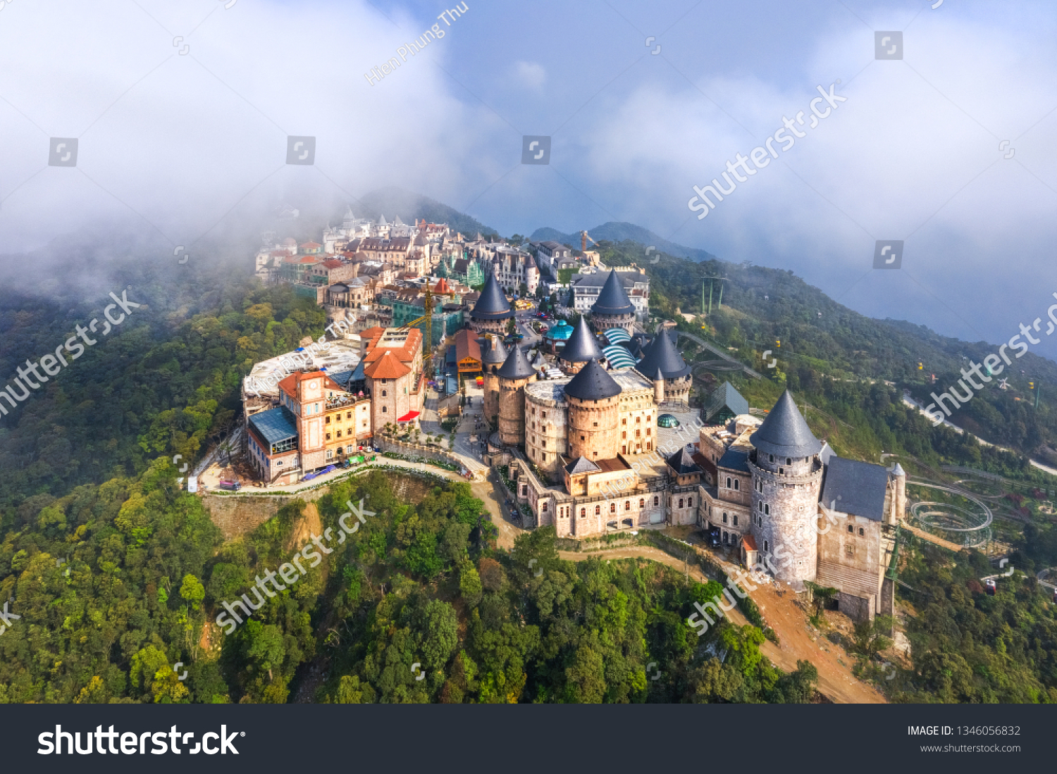 Aerial view of landscape is castles covered with fog at the top of Bana Hills, the famous tourist destination of Da Nang, Vietnam. Near Golden bridge. #1346056832