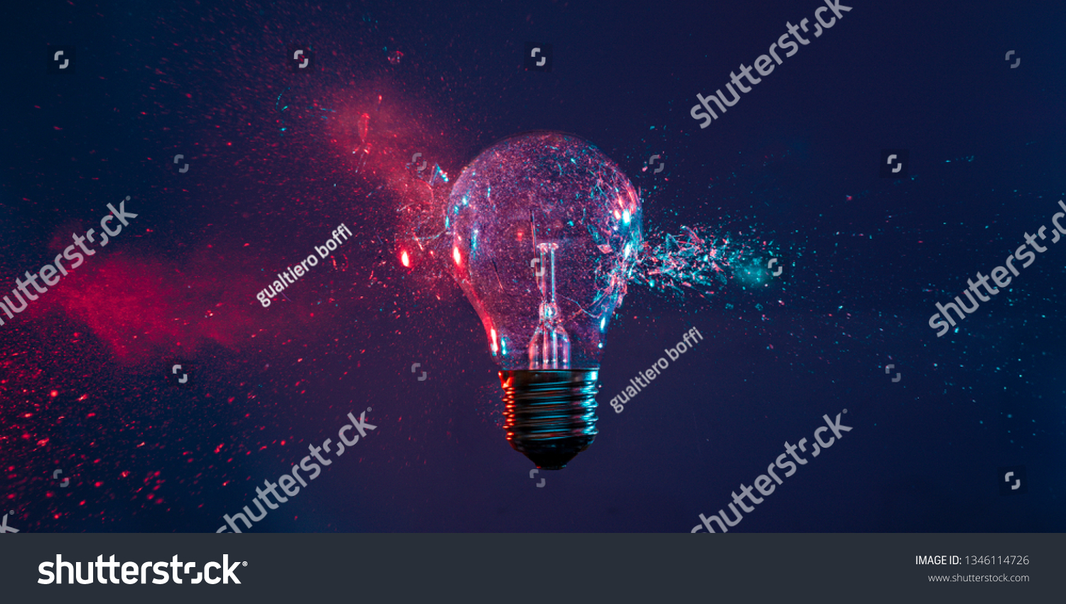 High speed studio photography, moment of the impact of a bullet on a classic electric bulb. Detail of glass explosion, blue and purple lighting. Concept of obsolete energy. #1346114726