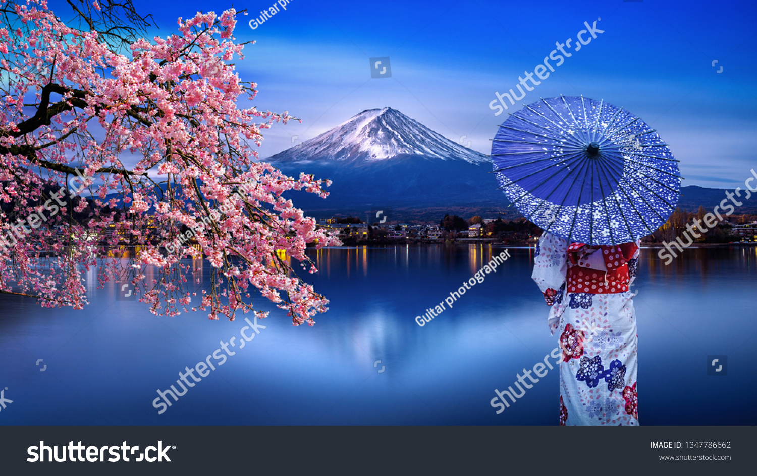 Asian woman wearing japanese traditional kimono at Fuji mountain and cherry blossom, Kawaguchiko lake in Japan. #1347786662