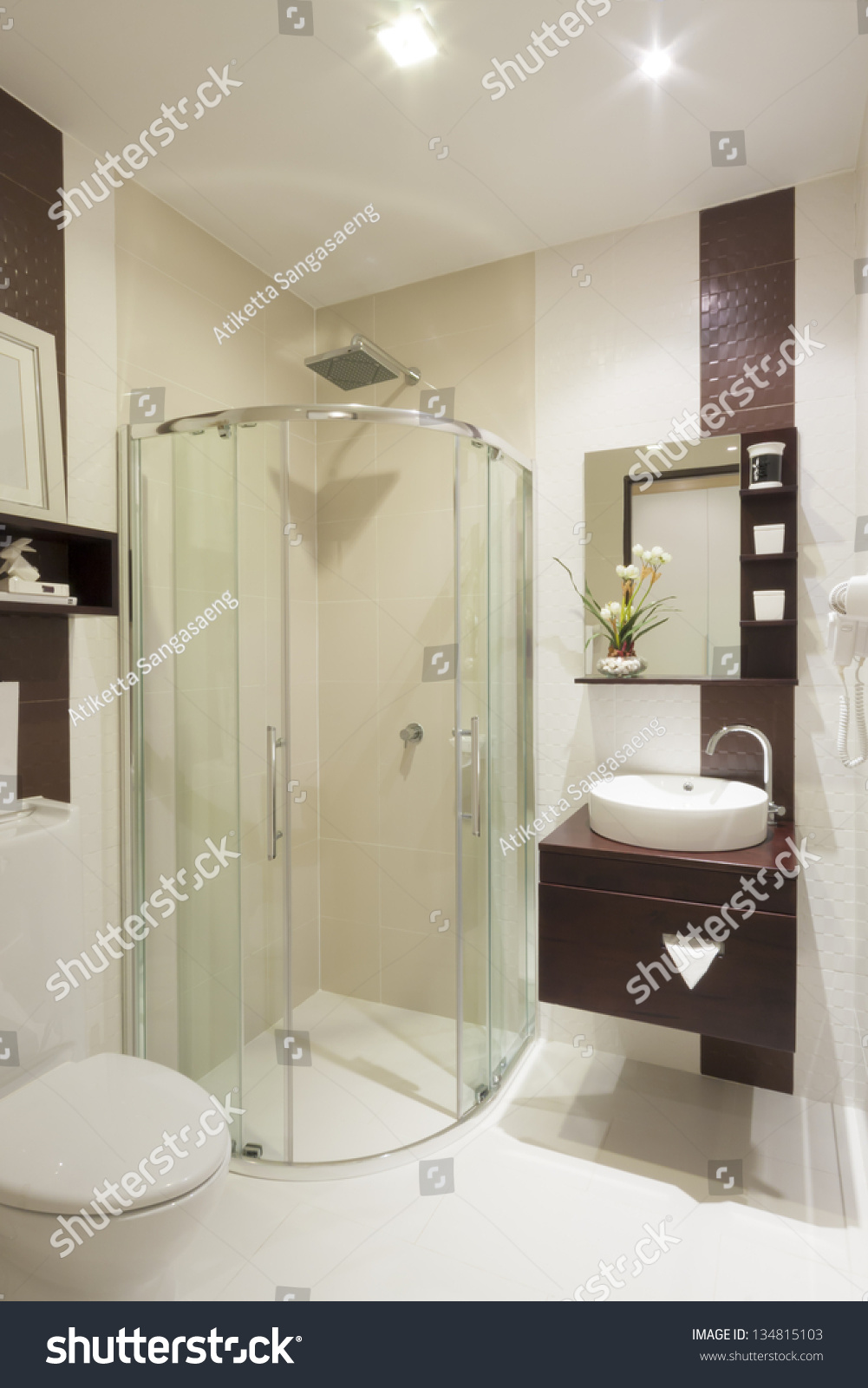 A modern, marble tile bathroom with an open walk-in shower and ...