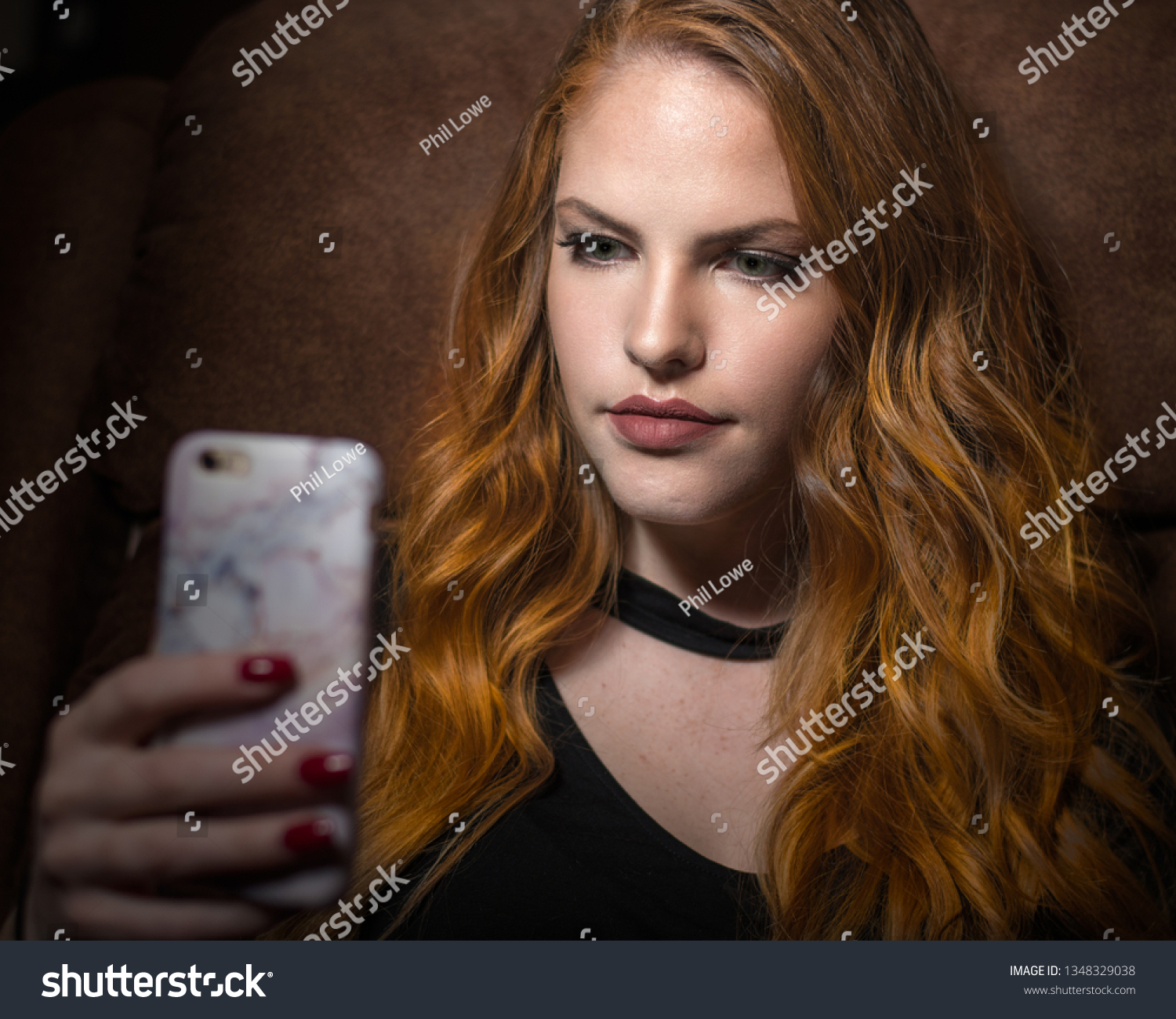 stock-photo-beautiful-young-red-haired-w