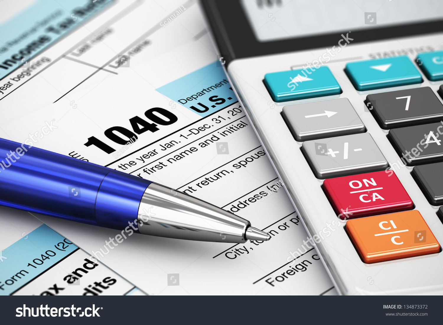 Macro view of 1040 us tax form calculator and ballpoint for 1040 tax table calculator