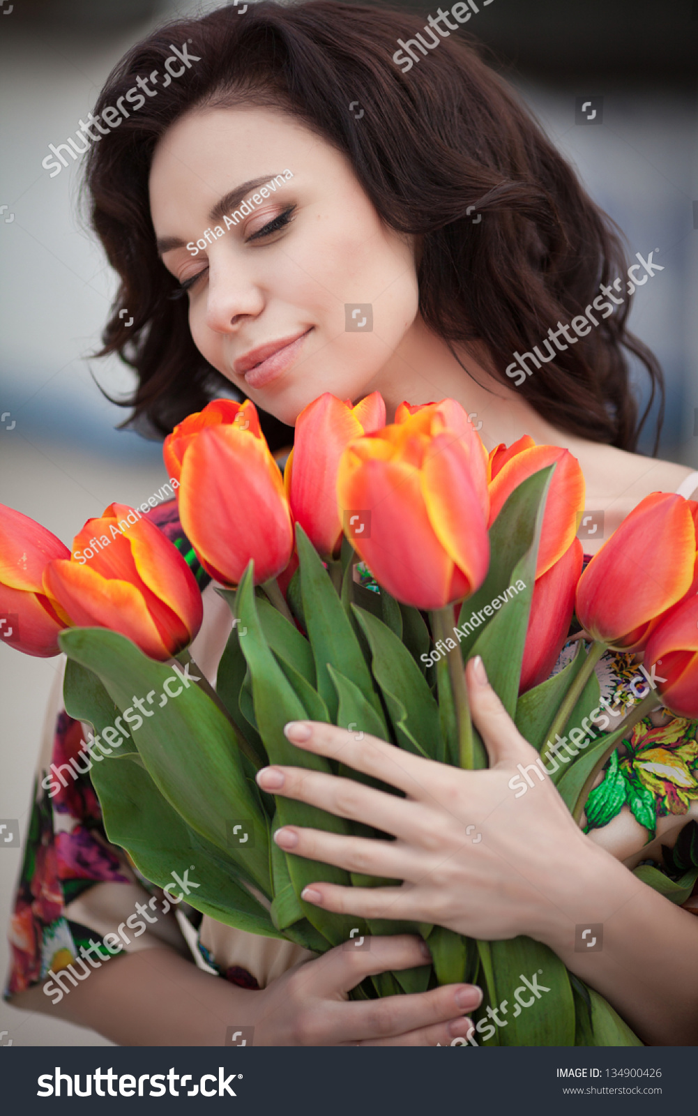 Beautiful woman flowers bouquet spring park stock photo royalty beautiful woman with flowers bouquet in spring park outdoors romantic sexy girl with tulips flowers izmirmasajfo