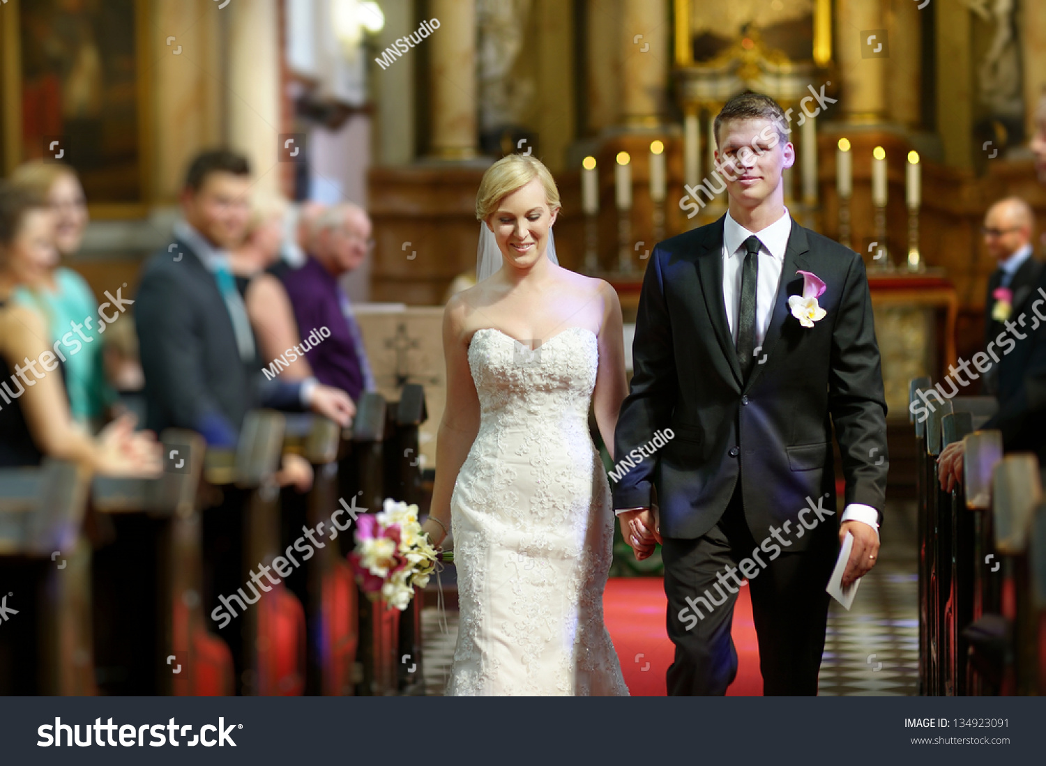 Bride And Groom Leaving The Church After A Wedding