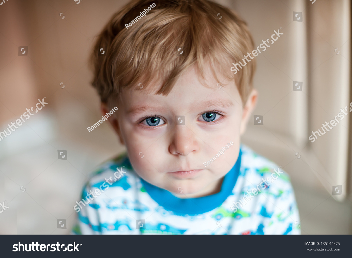crying toddler boy blue eyes blond stock photo 135144875