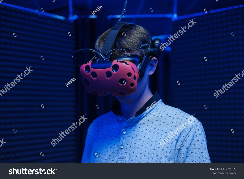 Man Plays Virtual Reality Using Glasses Stock Photo (Edit