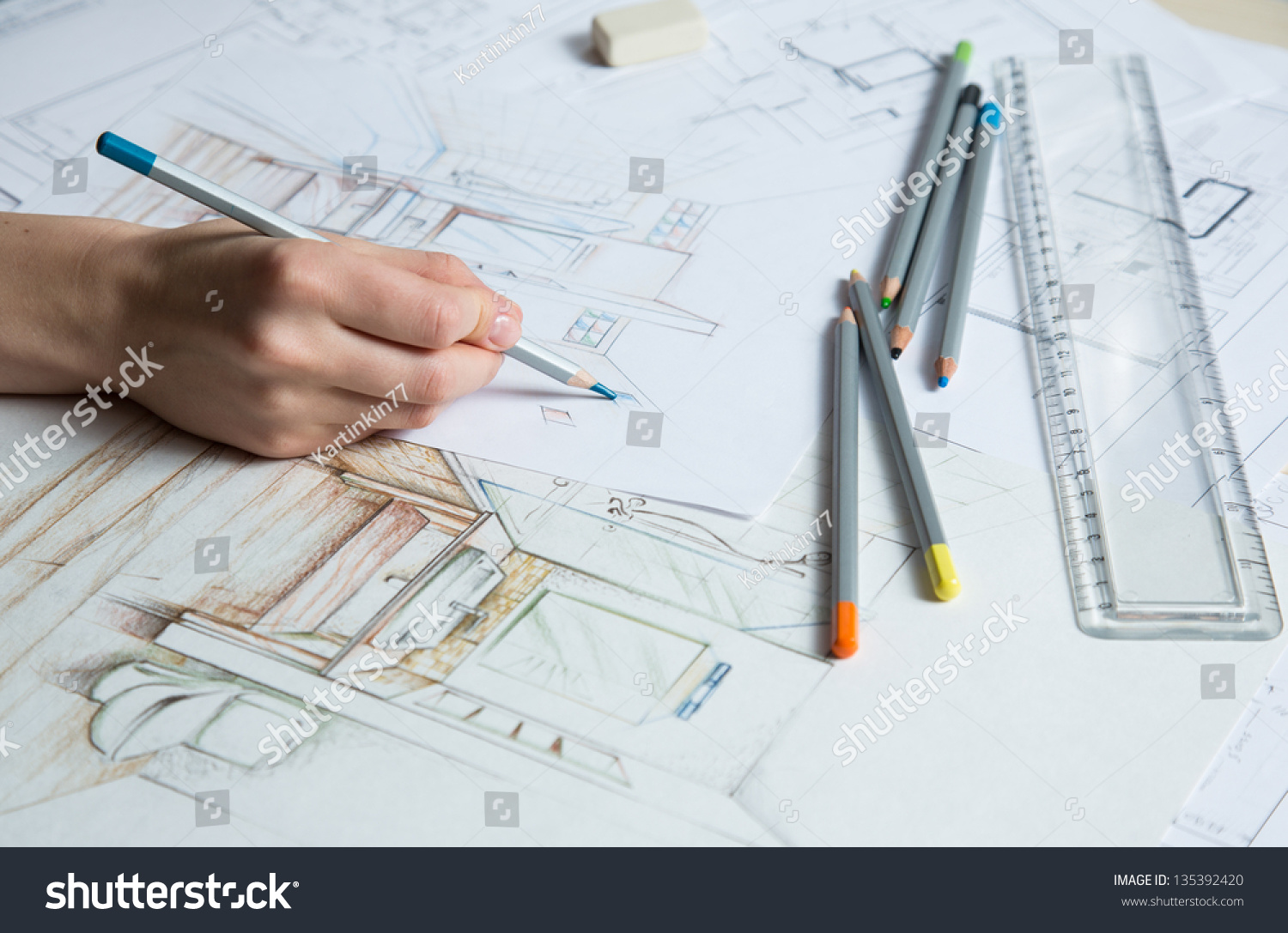 Interior designer works on hand drawing stock photo for Interior design color planner
