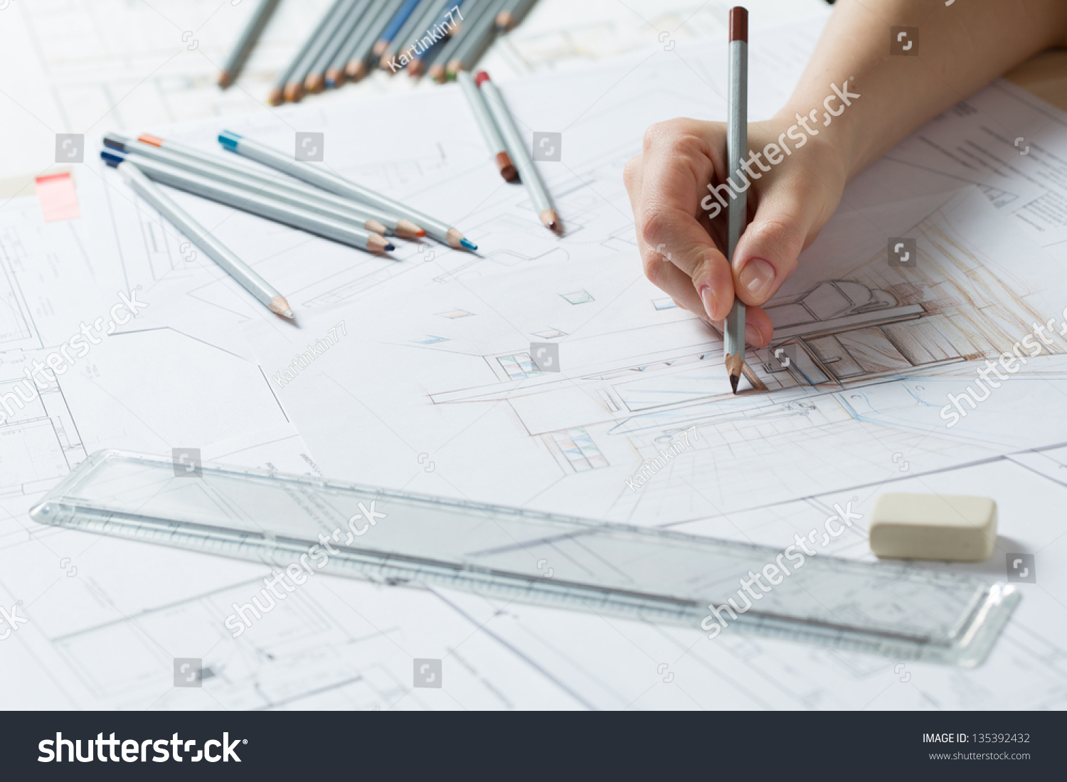 Interior Designer Works On A Hand Drawing Sketch Using Color