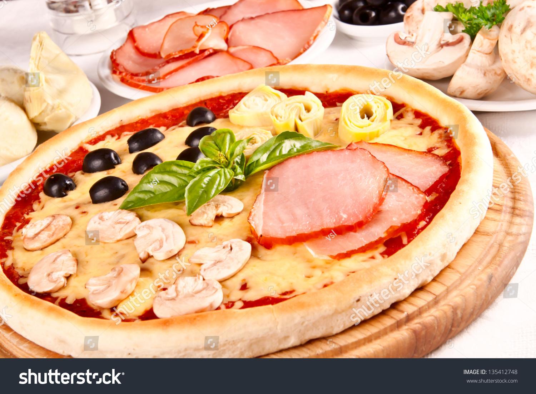 italian four seasons pizza pizza quattro stock photo. Black Bedroom Furniture Sets. Home Design Ideas