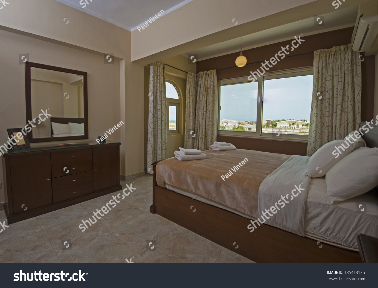 show home interior design. Bedroom in a luxury apartment show home with interior design Luxury Apartment Show Home Interior Stock Photo 135413135