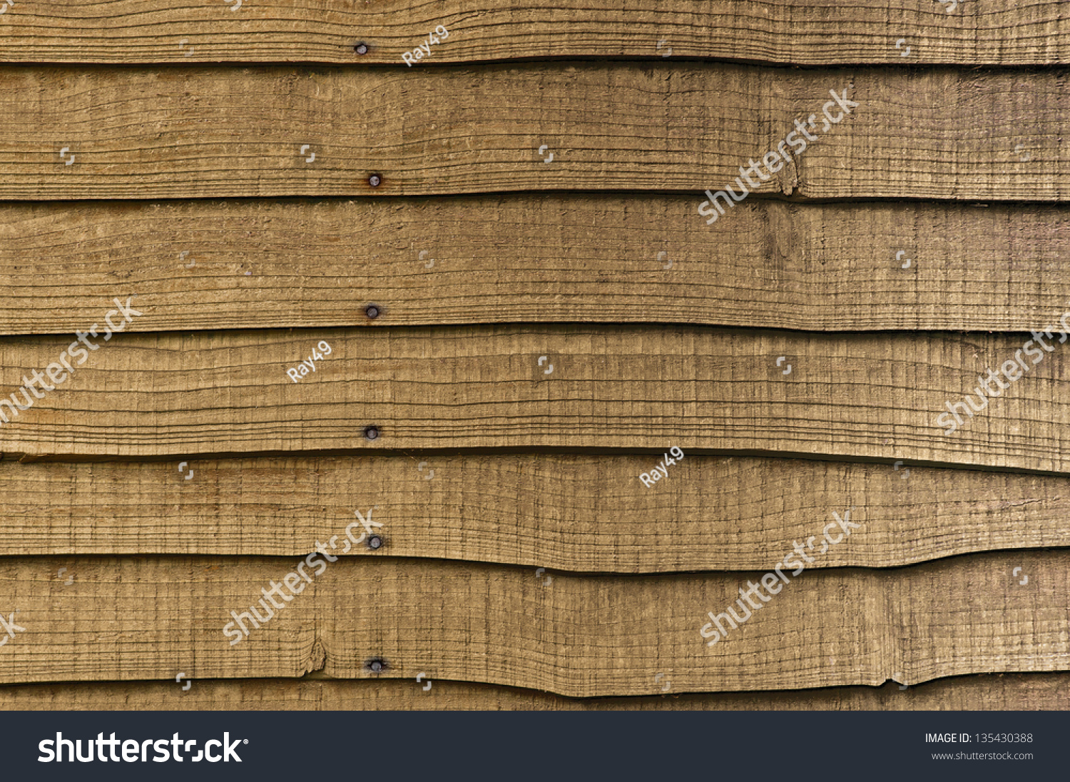 Horizontal Wood Fence Texture section horizontal overlapped wooden garden fencing stock photo