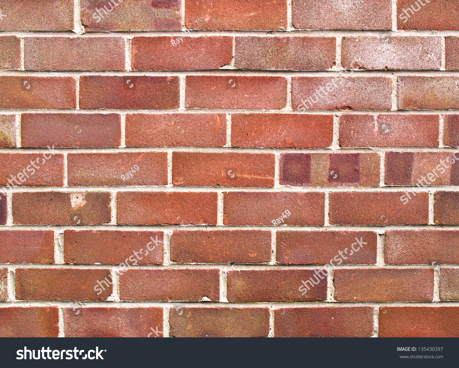 A Close Up Of A Section Of A Red Brick House Wall Stock