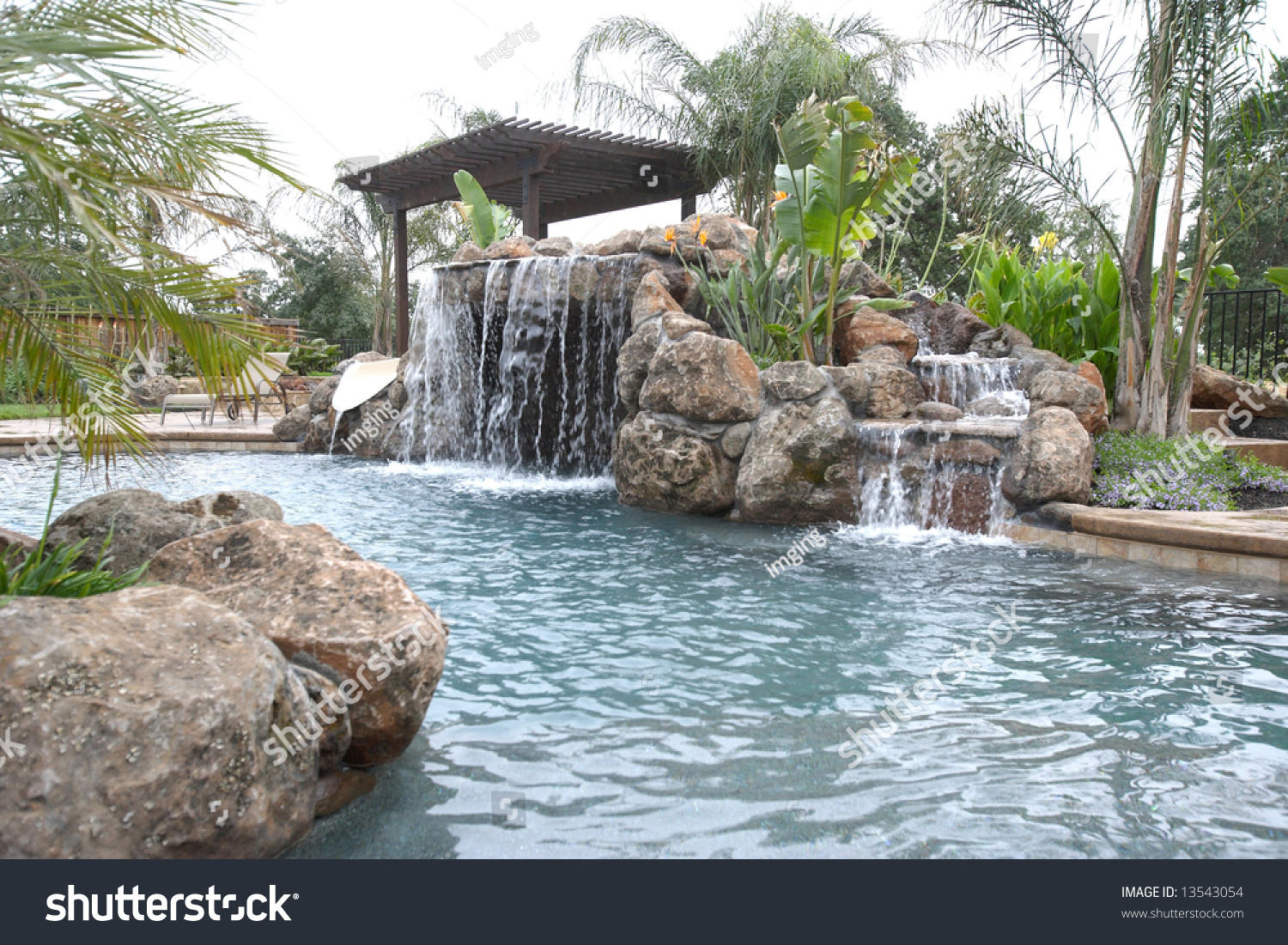 waterfall pool luxury backyard tropical landscaping stock photo