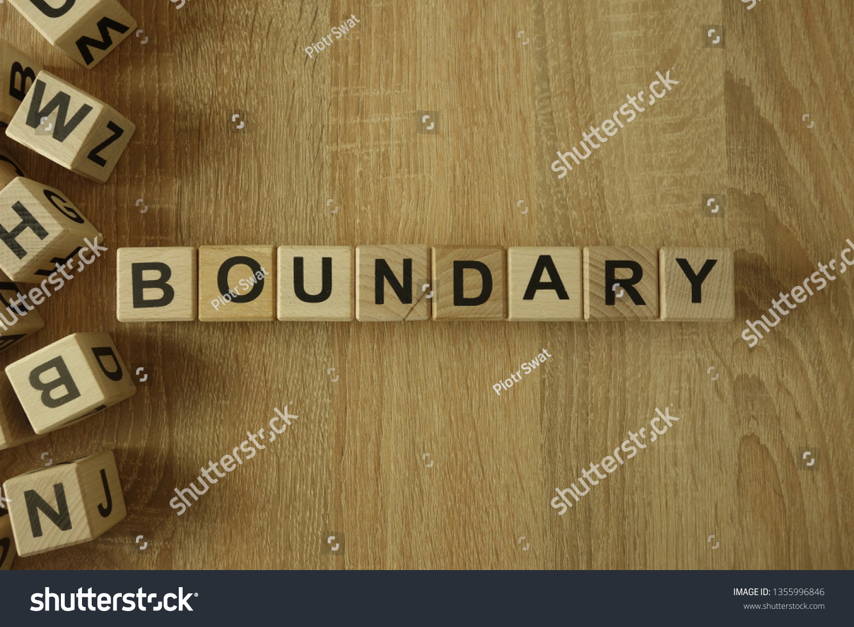 Boundary word from wooden blocks on desk #1355996846