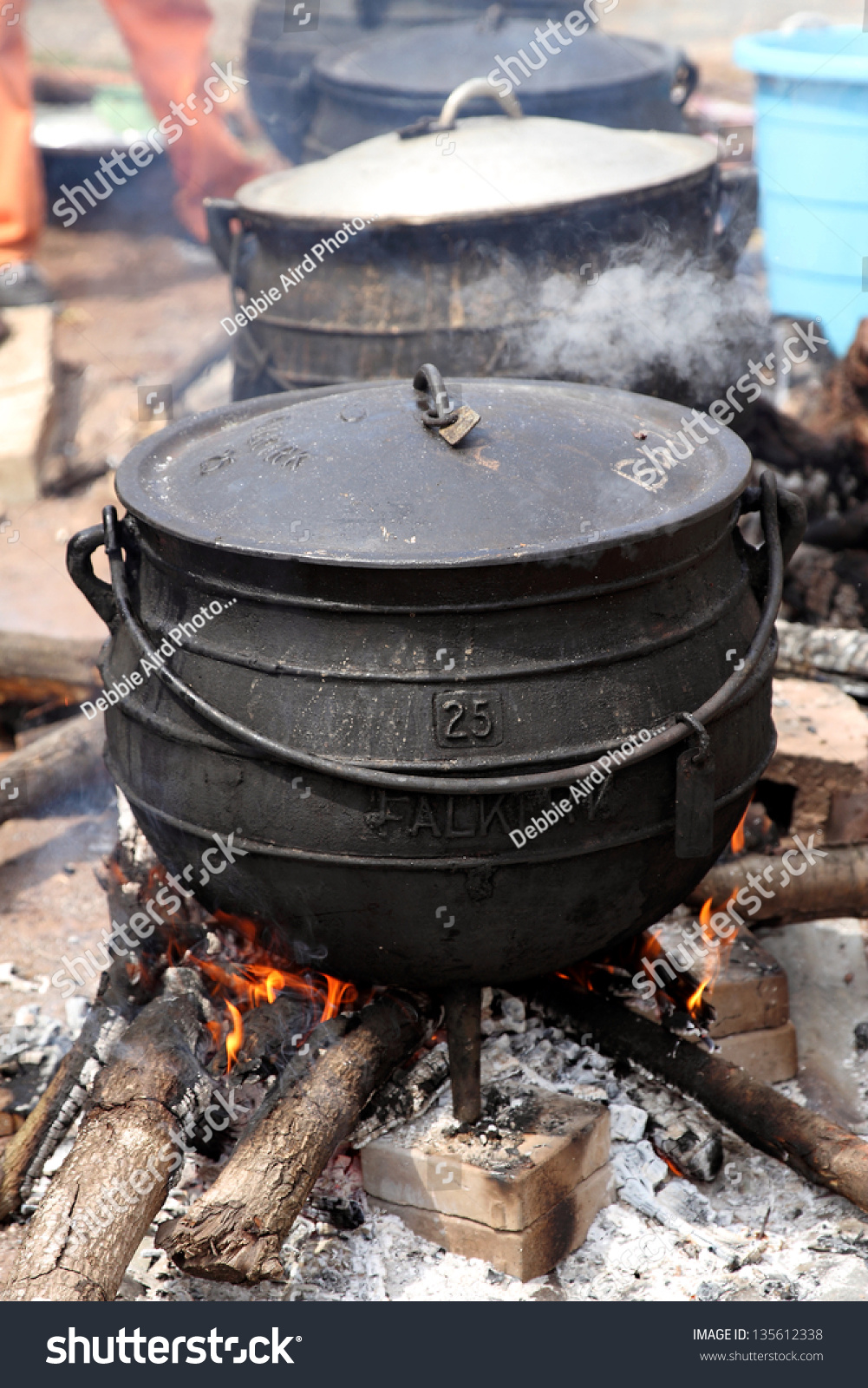 Cast Iron Cooking Pots On Wood Stock Photo 135612338