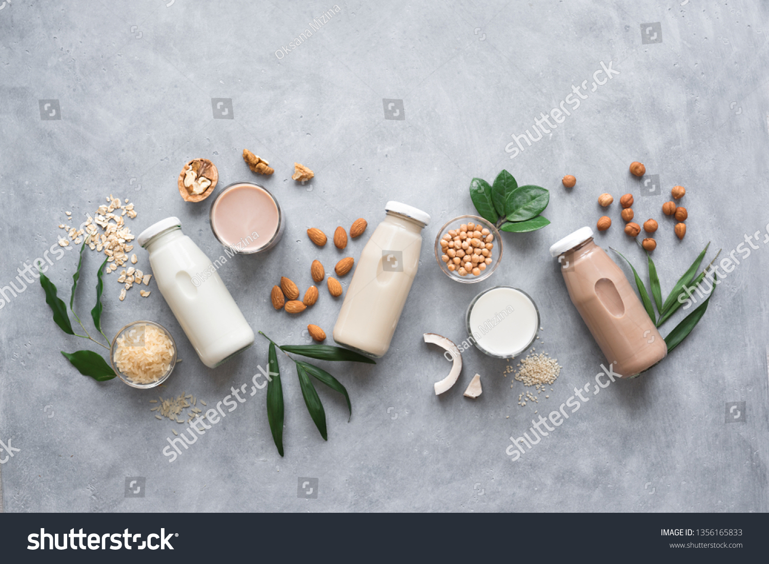 Various vegan plant based milk and ingredients, top view, copy space. Dairy free milk substitute drink, healthy eating. #1356165833