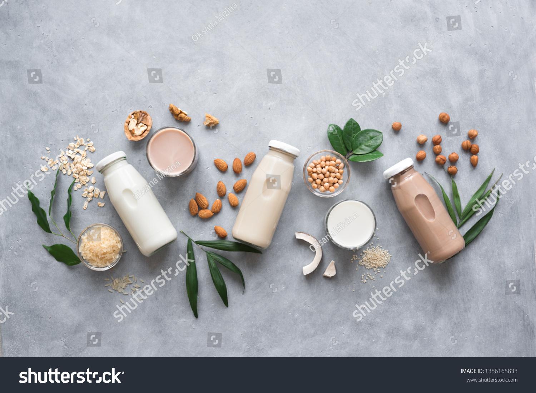 Various vegan plant based milk and ingredients, top view, copy space. Dairy free milk substitute drink, healthy eating. #1356165833