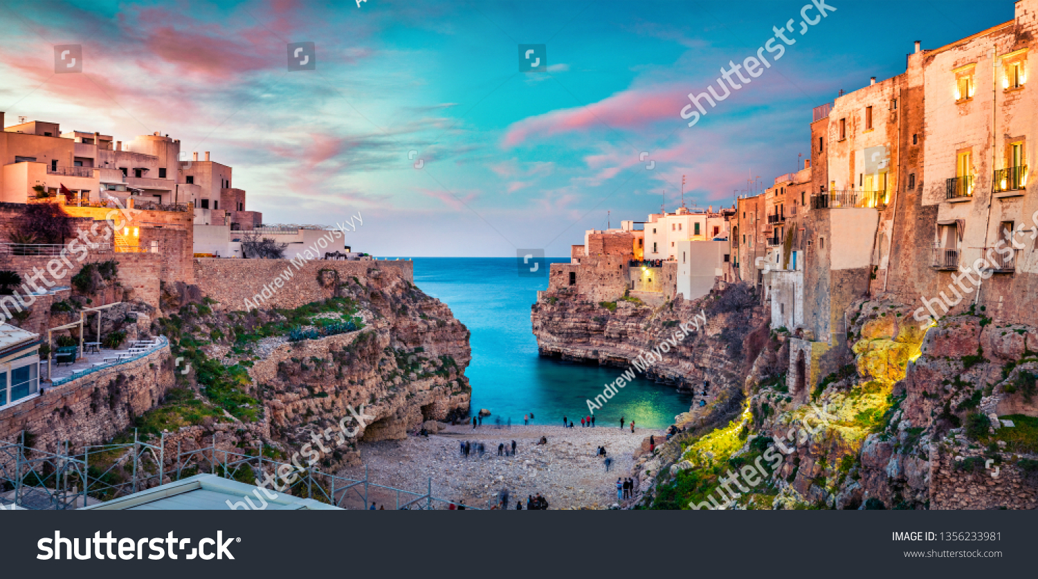 Spectacular spring cityscape of Polignano a Mare town, Puglia region, Italy, Europe. Colorful evening seascape of Adriatic sea. Traveling concept background. #1356233981